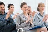 13025912-happy-business-group-of-people-clapping-hands-during-a-meeting-conference