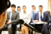 9163127-image-of-microphone-being-used-by-speaker-during-lecture-at-conference